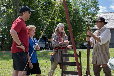 LEAD USE -James_Muro_and_his_son_Charlie_discuss_muskets_with_reenactors Deb Goodman (center) and_Matthew_Dickinson