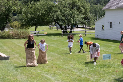06-Monica_Hyjek_and_her_daughter_Lena_challenged_each_other_to_a_sack_race_while_kids_played_other_traditional_games_nearby