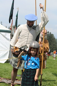 Kevin Stewart and Liam Osgood, age 5, play with historical Scottish weapons