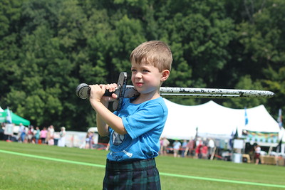 Liam Osgood, 5, trys out a sword at the Historic Highlanders Living History tent