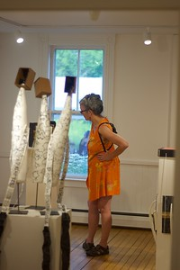 Linda Treash walks around the exhibits