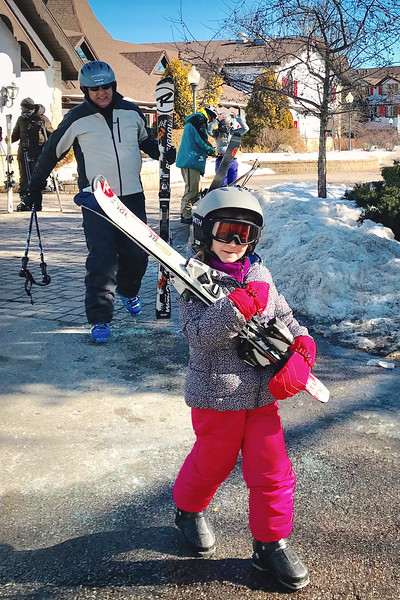 A true skier carries her own skis