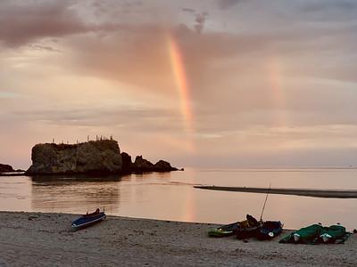 Rainbows over bay