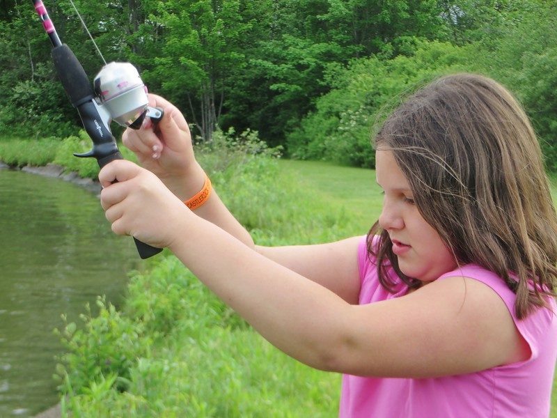 PHOTOS BY jENN SMITH — THE BERKSHIRE EAGLE <br /> Ten-year-old Casey Haberern focuses on reeling in a catch during Saturday's Harry A. Bateman Memorial Jimmy Fund Fishing Derby in Pittsfield.