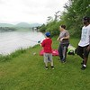PHOTOS BY JENN SMITH — THE BERKSHIRE EAGLE <br /> Kiandre Head and Melinda Ketchum watch as Taven Myers, 9, of Cub Scout Pack 20 waits for his first catch during Saturday's Harry A. Bateman Memorial Jimmy Fund Fishing Derby in Pittsfield.
