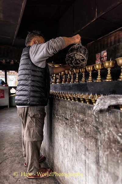 Tending Butter Lamps at Kari La Pass, Bhutan