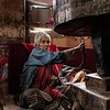 Elderly Woman Turns A Prayer Wheel
