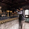 Filling Butter Lamps at Kari La Pass