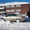 Benjamin Coil of Farmland Rd., in Lowell shoveling outhis car. (The Sun / Chris Tierney)