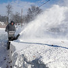 Dracut resident Noel Keane snowblowing walkway.<br /> (The Sun / Chris Tierney)