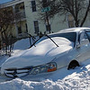 Car plowed in our  Hampshire st., in Lowell. (The Sun / Chris Tierney)