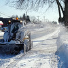 Mike Andrews of the Dracut School Department clearing the sidewalks on Lakeview ave.<br /> (The Sun / Chris Tierney)