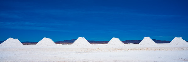 The visible salt is actually a crust over a lake of brine, which renews that salt continuously. It is harvested for local use.