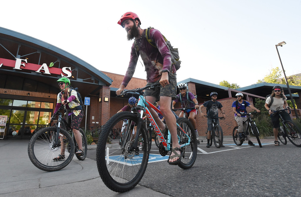 . Camilla Hallin, left, and Zac Davis, lead out the Avid4 Adventure tribe from the Alfalfa\'s station during Boulder\'s Bike to Work Day on Wednesday. For more photos, go to dailycamera.com. Cliff Grassmick  Staff Photographer  June 27, 2018