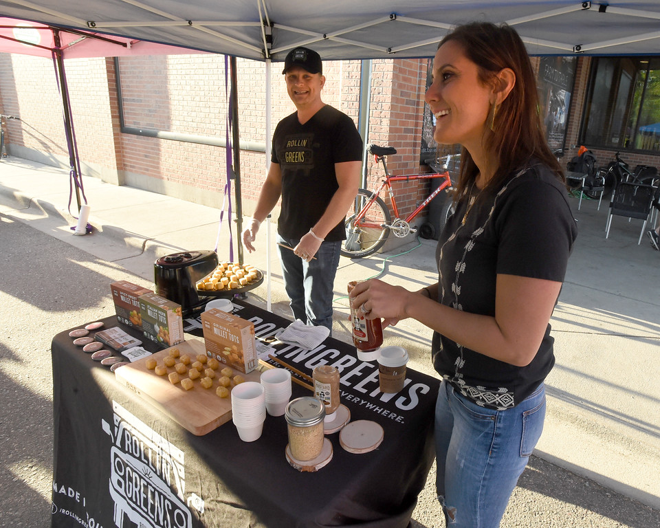 . Ryan and Lindsey Cunningham, of Rollin Greens, give out millet tots at the Alfalfa\'s Bike Station during Boulder\'s Bike to Work Day on Wednesday. For more photos, go to dailycamera.com. Cliff Grassmick  Staff Photographer  June 27, 2018