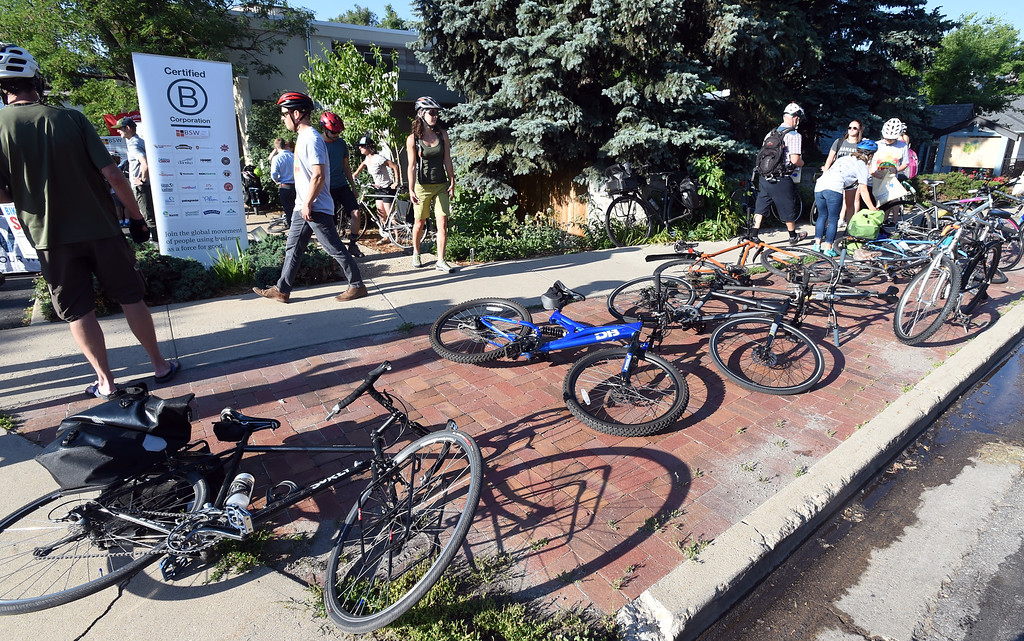 . Riders park their bikes at  the BSW Wealth Partners bike station along Pearl Street during Boulder\'s Bike to Work Day on Wednesday. For more photos, go to dailycamera.com. Cliff Grassmick  Staff Photographer  June 27, 2018