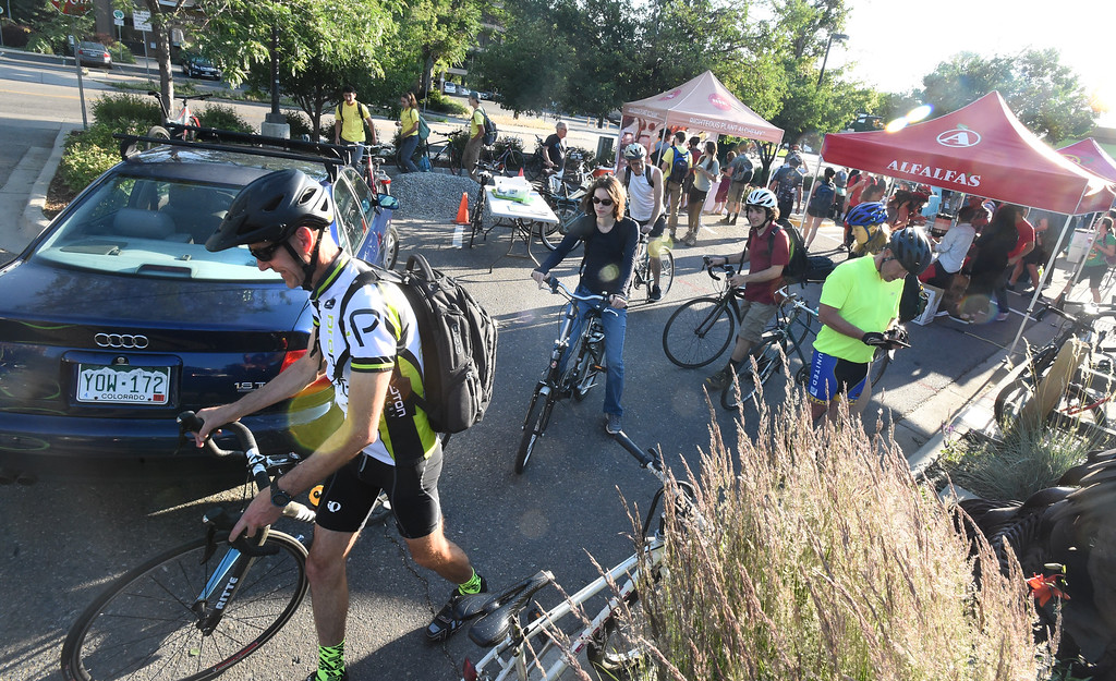 . Hundreds of riders go in and out of the Alfalfa\'s bike station during Boulder\'s Bike to Work Day on Wednesday. For more photos, go to dailycamera.com. Cliff Grassmick  Staff Photographer  June 27, 2018
