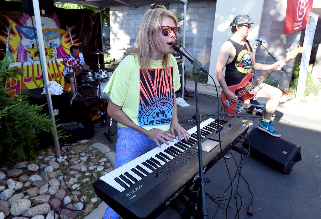 . Ashley Eyre and the Goonies entertain riders at the BSW Wealth Partners bike station during Boulder\'s Bike to Work Day on Wednesday. For more photos, go to dailycamera.com. Cliff Grassmick  Staff Photographer  June 27, 2018