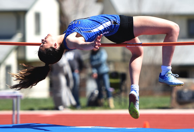 Longmont's Sam Chacon clears the high jump bar during the Boulder County Invitational on Saturday, April 14, at Centaurus High School.