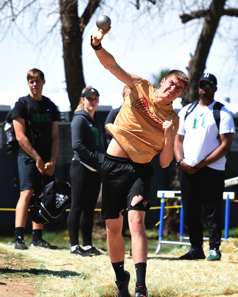 Skyline's Henry Carlson competes in the shot put during the Boulder County Invitational on Saturday, April 14, at Centaurus High School.