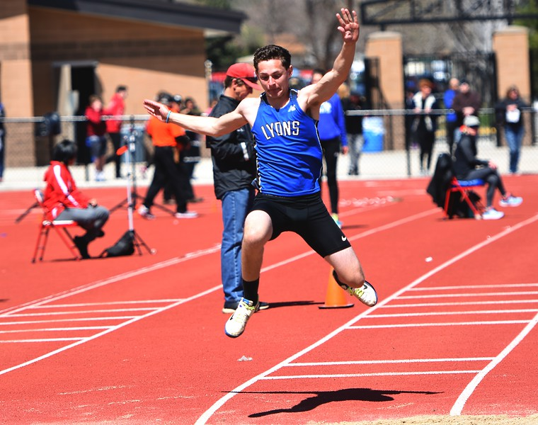 Lyons jumper Tristan Chavez competes in the triple jump during the Boulder County Invitational on Saturday, April 14, at Centaurus High School.