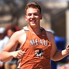 Mead's Jaxon Bennett celebrates as he retrieves his shot following a personal-best throw during the Boulder County Invitational on Saturday, April 14, at Centaurus High School.