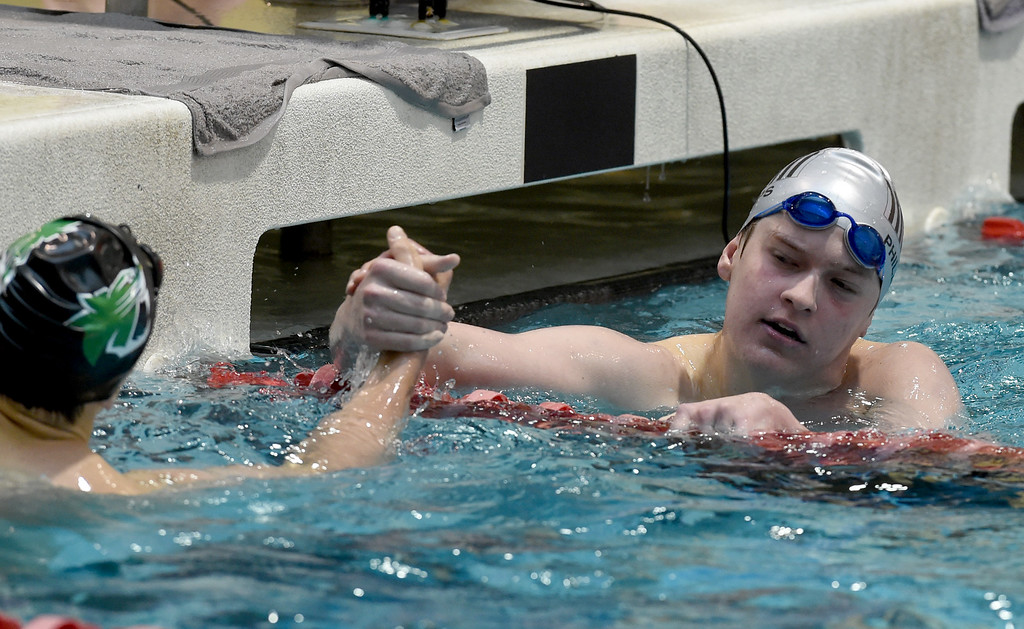 . John Paul Phillip, right,of Fairview,  congratulates Danny Kovac, of Fossil Ridge, after the 200 yard freestyle during the 2018 Boys\' Mustang Invitational in Thornton on Saturday. For more photos go to BoCoPreps.com. Cliff Grassmick  Photographer  April 21, 2018