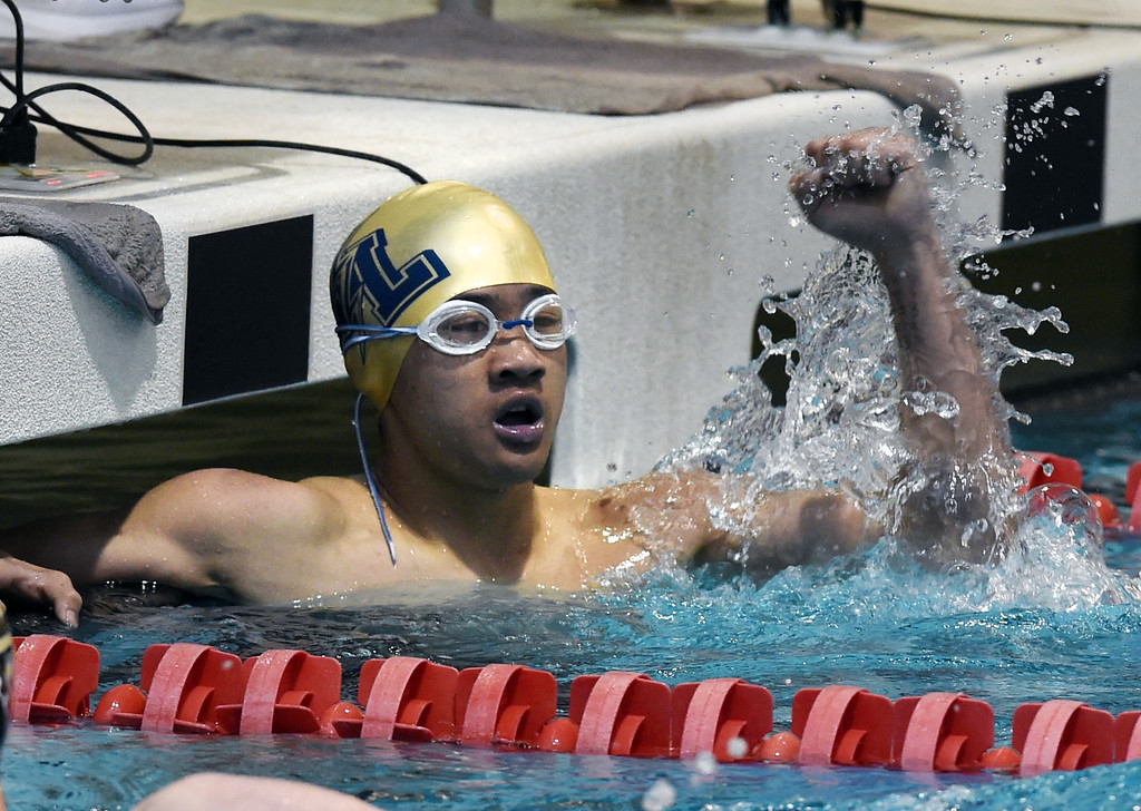 . Nicholas Torres, of Legacy, celebrates his time in the 200 yard IM during the 2018 Boys\' Mustang Invitational in Thornton on Saturday. For more photos go to BoCoPreps.com. Cliff Grassmick  Photographer  April 21, 2018