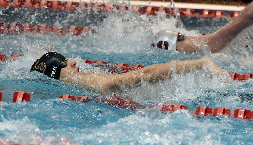 . Josh Winter, of Boulder,  competes in the 200 yard medley relay during the 2018 Boys\' Mustang Invitational in Thornton on Saturday. For more photos go to BoCoPreps.com. Cliff Grassmick  Photographer  April 21, 2018