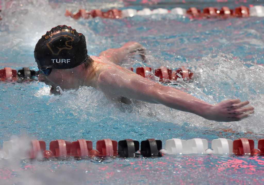 . CJ Turf, of Boulder, competes in the 100 yard butterfly,during the 2018 Boys\' Mustang Invitational in Thornton on Saturday. For more photos go to BoCoPreps.com. Cliff Grassmick  Photographer  April 21, 2018
