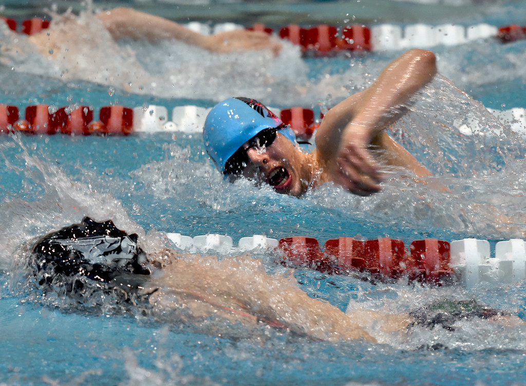 . Octavio Querol, of Longmont, competes in the 200 yard freestyle during the 2018 Boys\' Mustang Invitational in Thornton on Saturday. For more photos go to BoCoPreps.com. Cliff Grassmick  Photographer  April 21, 2018