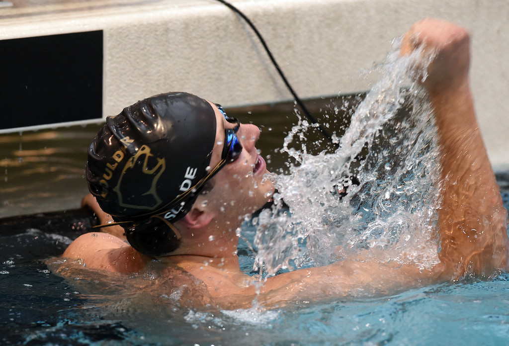 . Matt Slade, of Boulder, is happy after the 100 yard butterfly during the 2018 Boys\' Mustang Invitational in Thornton on Saturday. For more photos go to BoCoPreps.com. Cliff Grassmick  Photographer  April 21, 2018