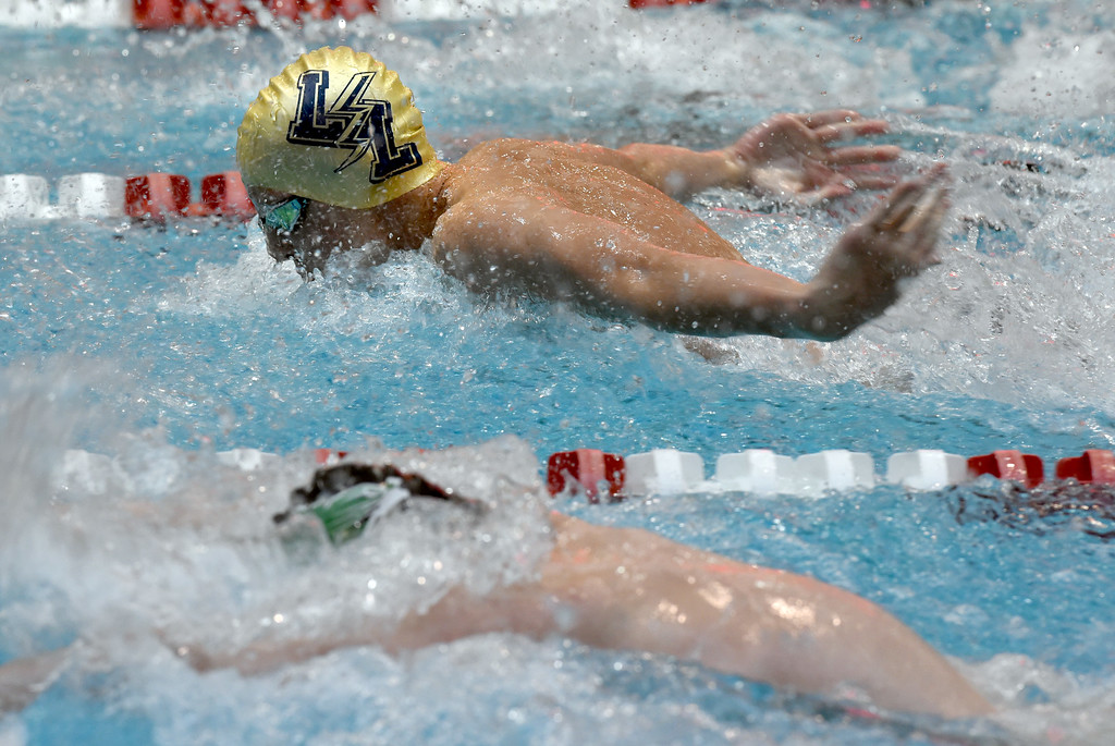 . Luke Miller, of Legacy, competes in 100 yard butterfly during the 2018 Boys\' Mustang Invitational in Thornton on Saturday. For more photos go to BoCoPreps.com. Cliff Grassmick  Photographer  April 21, 2018