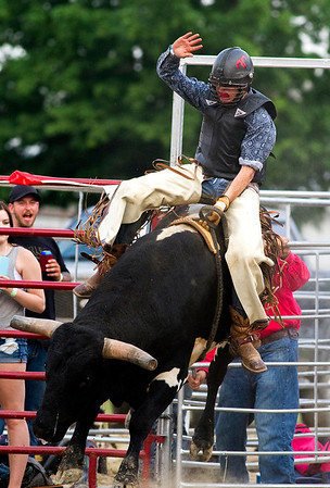 Bull rider Cal Spence catches some air during Saturday's second annual Buckin For Wishes rodeo in Altamont.<br /> Keith Stewart Photo