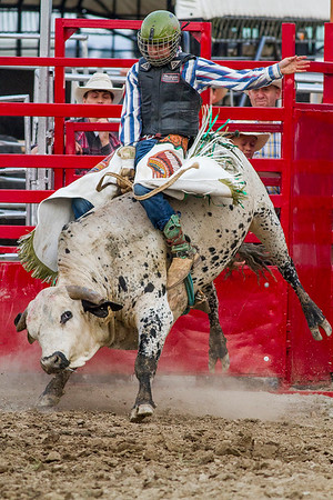 Dalton Mann stays atop his bull during Saturday's second annual Buckin For Wishes rodeo in Altamont.<br /> Keith Stewart Photo