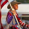 Dakota Murphy sits atop her horse in patriotic garb during Saturday's second annual Buckin' For Wishes rodeo in Altamont.<br /> Keith Stewart Photo