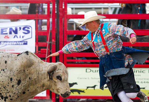 Bullfighter Cooper Wells tries to keep his distance from a bull during Saturday's second annual Buckin' For Wishes Rodeo in Altamont.<br /> Keith Stewart Photo