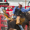 Professional bull rider Will Crain of St. Peter stays atop his bull during the first round of Saturday's second annual Buckin' For Wishes Rodeo in Altamont. Will won the competition scoring a total of 178 across three rounds.<br /> Keith Stewart Photo