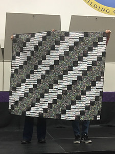 Renee Fisher showed us a quilt that was made by a sister that lives in Midland.  It is for the Teal Project.  It was also quilted by Renee's sister.