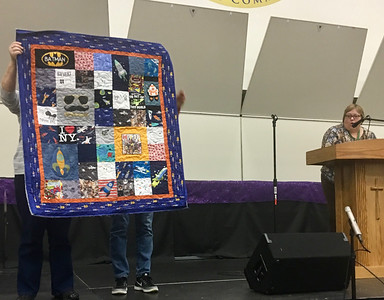 Cindy Reisig showing us Rowan's Rockets.  A tee shirt quilt for a two year old in Chicago.   Quilted by Nancy Boyse.
