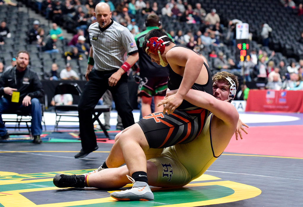 . Holy Family High School\'s Andrew Edwards takes down La Junta\'s Nick Martinez during a 3A 285-pound first round match during day 1 of the CHSAA State Wrestling Tournament at the Pepsi Center in Denver. More photos: BoCoPreps.com Jeremy Papasso/ Staff Photographer 02/15/2018