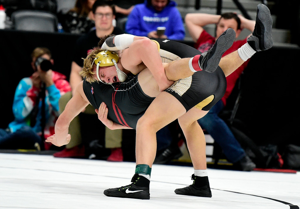 . Monarch High School\'s Parker McQuade wrestles Rocky Mountain\'s Neil Davis during a 5A 152-pound first round match during day 1 of the CHSAA State Wrestling Tournament at the Pepsi Center in Denver. More photos: BoCoPreps.com Jeremy Papasso/ Staff Photographer 02/15/2018