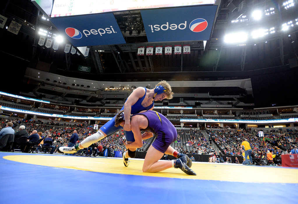 . Lyons High School\'s Oran Huff, at top, wrestles Colton  Sims, of Rye High School, during a 2A 126-pound first round match during day 1 of the CHSAA State Wrestling Tournament at the Pepsi Center in Denver. More photos: BoCoPreps.com Jeremy Papasso/ Staff Photographer 02/15/2018