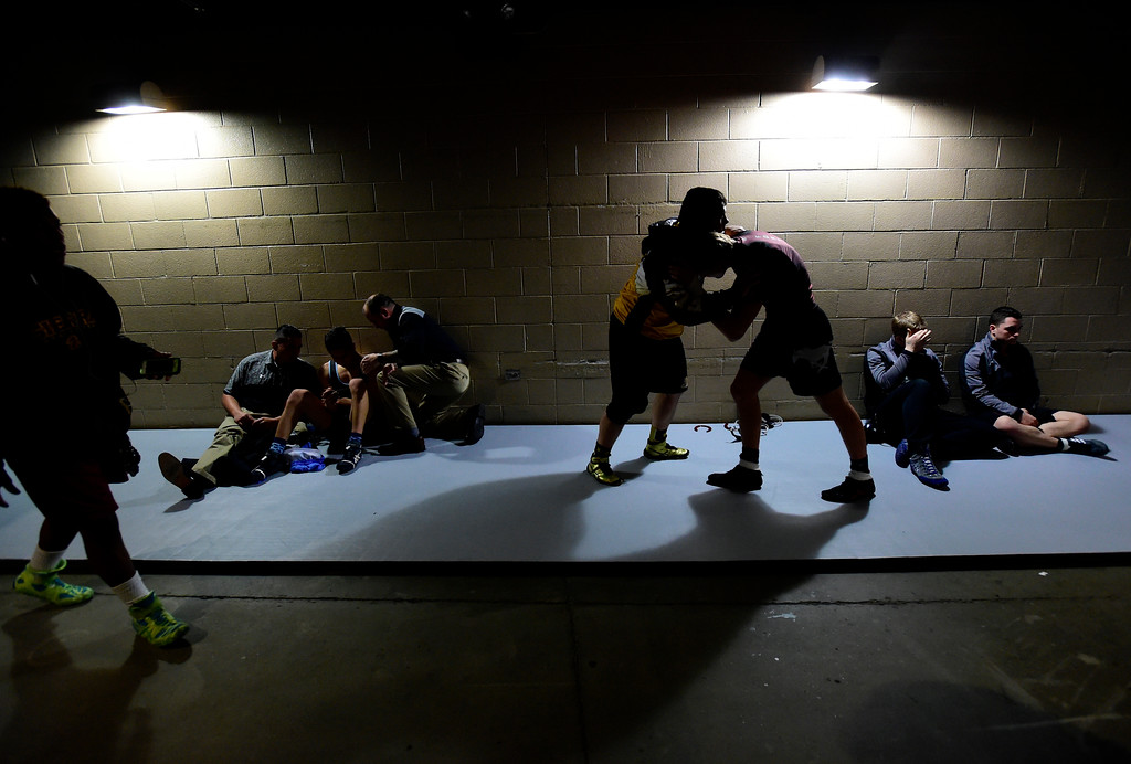 . High School wrestlers warm up before their matches during the first round of the CHSAA State Wrestling Tournament at the Pepsi Center in Denver. More photos: BoCoPreps.com Jeremy Papasso/ Staff Photographer 02/15/2018