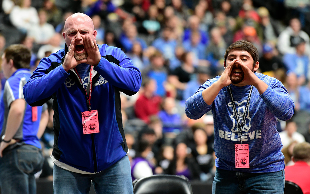 . Broomfield High School Head Coach Pat DeCamillis, left, and Assistant Coach Brandon Madril yell to Presley Madril during his  5A 113-pound first round match during day 1 of the CHSAA State Wrestling Tournament at the Pepsi Center in Denver. More photos: BoCoPreps.com Jeremy Papasso/ Staff Photographer 02/15/2018