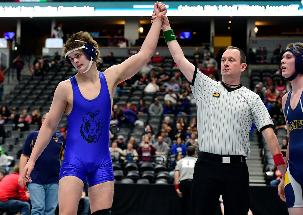 . Lyons High School\'s Karson Bean has his hand raised after defeating Hanover\'s Brandon Clark during a 2A 195-pound first round match during day 1 of the CHSAA State Wrestling Tournament at the Pepsi Center in Denver. More photos: BoCoPreps.com Jeremy Papasso/ Staff Photographer 02/15/2018