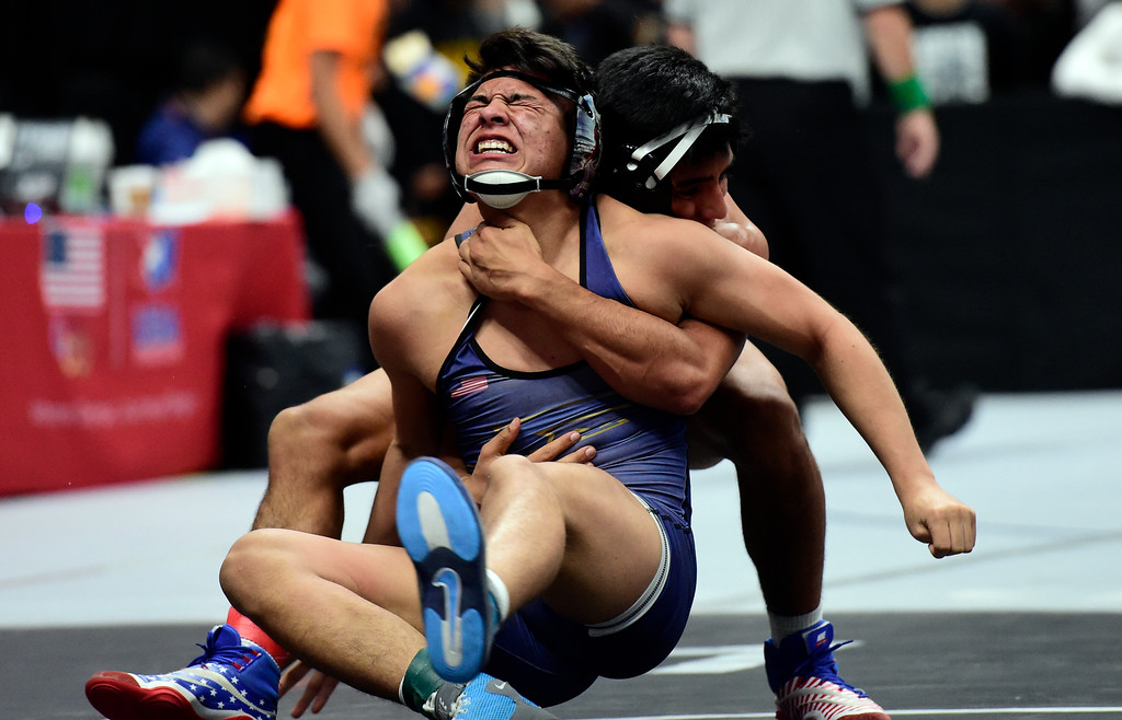 . Frederick High School\'s Victor Rangel wrestles Mesa Ridge\'s Elijah Valdez during a 4A 152-pound first round match during day 1 of the CHSAA State Wrestling Tournament at the Pepsi Center in Denver. More photos: BoCoPreps.com Jeremy Papasso/ Staff Photographer 02/15/2018