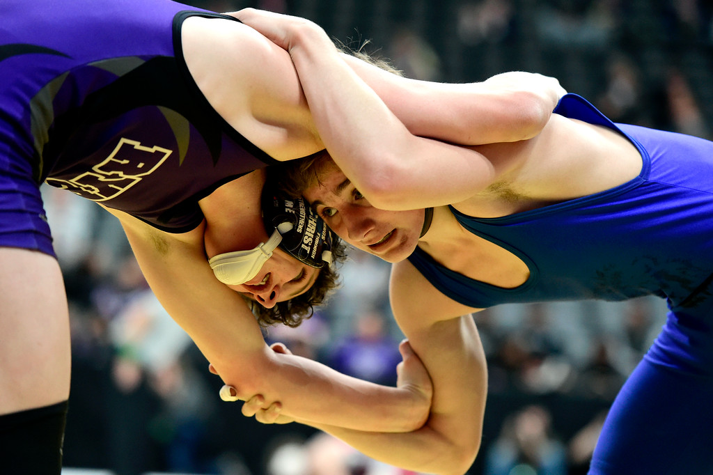 . Lyons High School\'s Oran Huff, at right, ties up with Colton  Sims, of Rye High School, during a 2A 126-pound first round match during day 1 of the CHSAA State Wrestling Tournament at the Pepsi Center in Denver. More photos: BoCoPreps.com Jeremy Papasso/ Staff Photographer 02/15/2018