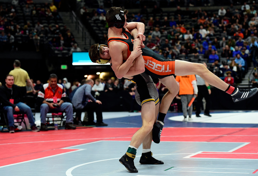 . Monarch High School\'s Cole Polluconi slams Grand Junction\'s Talen Valerio during a 5A 138-pound first round match during day 1 of the CHSAA State Wrestling Tournament at the Pepsi Center in Denver. More photos: BoCoPreps.com Jeremy Papasso/ Staff Photographer 02/15/2018