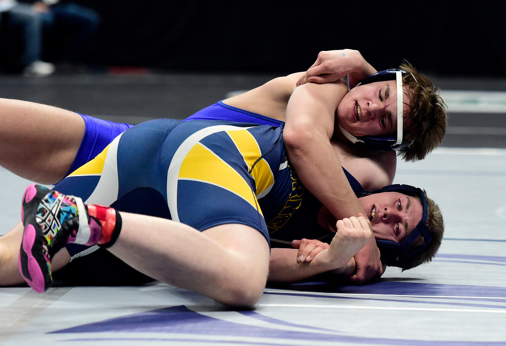 . Lyons High School\'s Carson Bean tries to pin Hanover\'s Brandon Clark during a 2A 195-pound first round match during day 1 of the CHSAA State Wrestling Tournament at the Pepsi Center in Denver. Bean won the match. More photos: BoCoPreps.com Jeremy Papasso/ Staff Photographer 02/15/2018